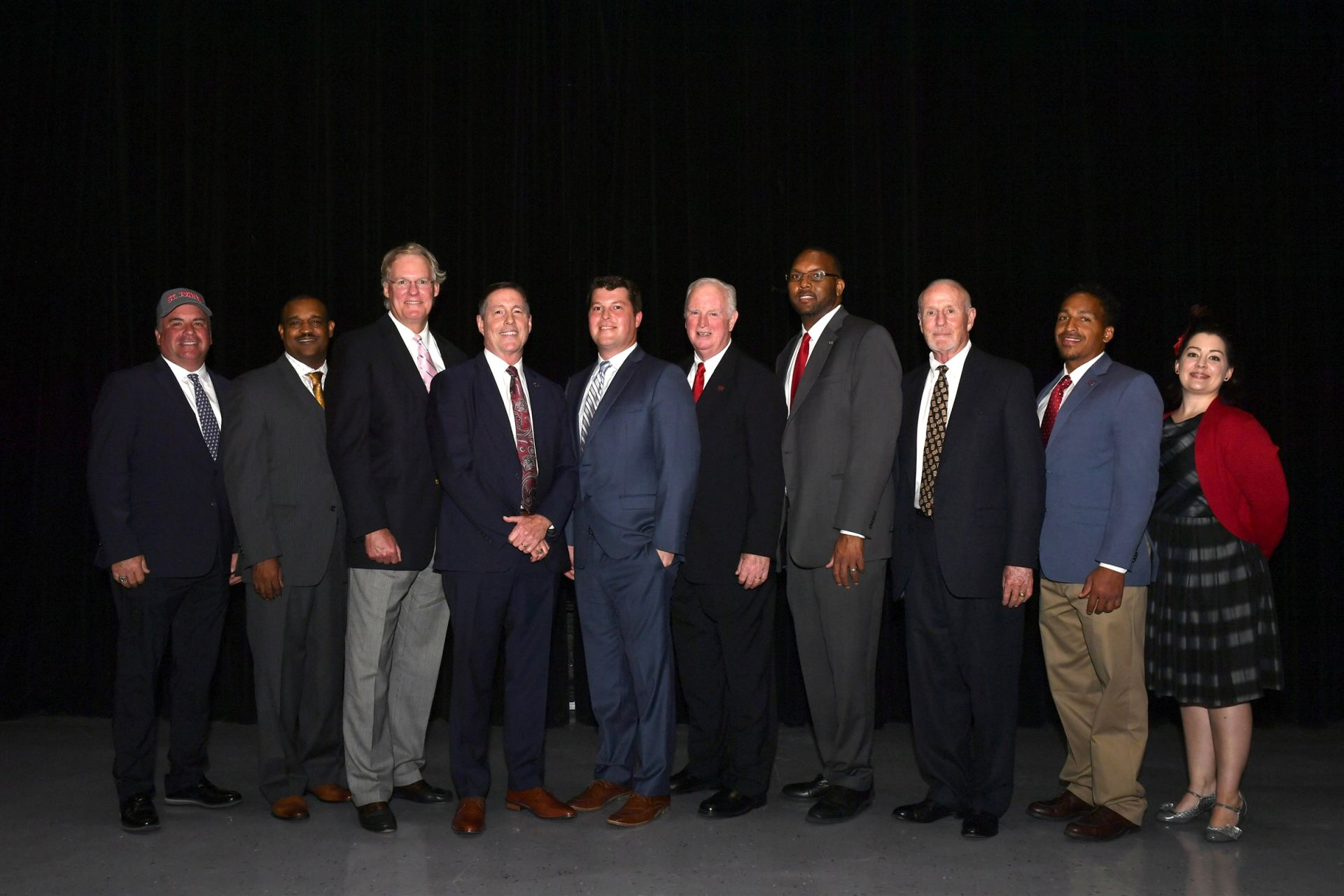 From left: Mike Lessel '77, Alvin Perkins '75, Mark Hartley '73, Stephen Zubrod '72, J.D. Ricca '02, Chris Dill '64, Darryl Gilliam '93, Ron Panneton '63, Anthony Coleman '08 (brother of Marissa Coleman '05) and Kate Bouterie '96 (accepting on behalf of Col. Richard Pfeiffer)