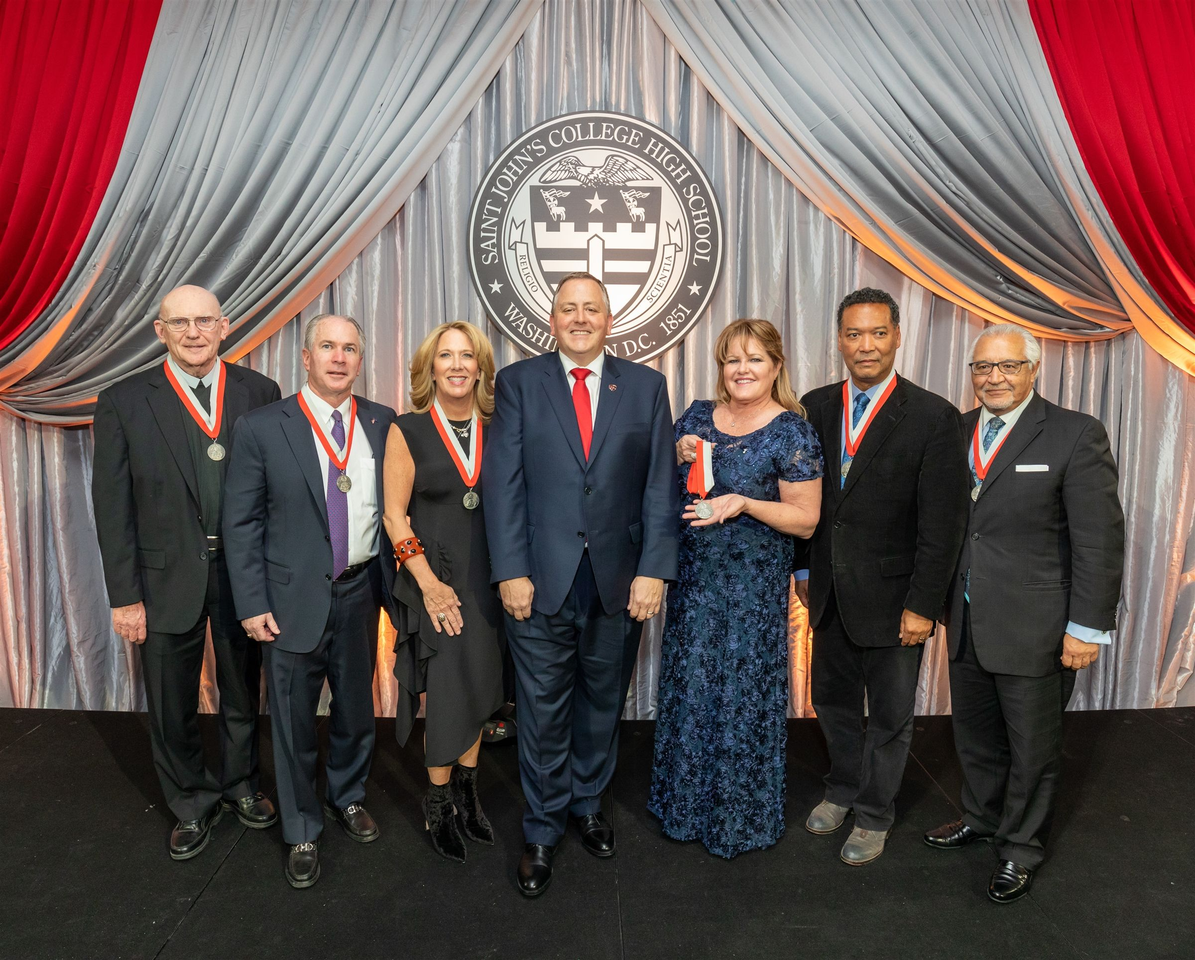 From left: Bro. Martin Zewe, Don and Laura Harlan, SJC President Jeff Mancabelli, Alison Ochoa, daughter of Maj. Gen. Ronald Beckwith '53, Kiko Washington '76 and Joe Bruno '67