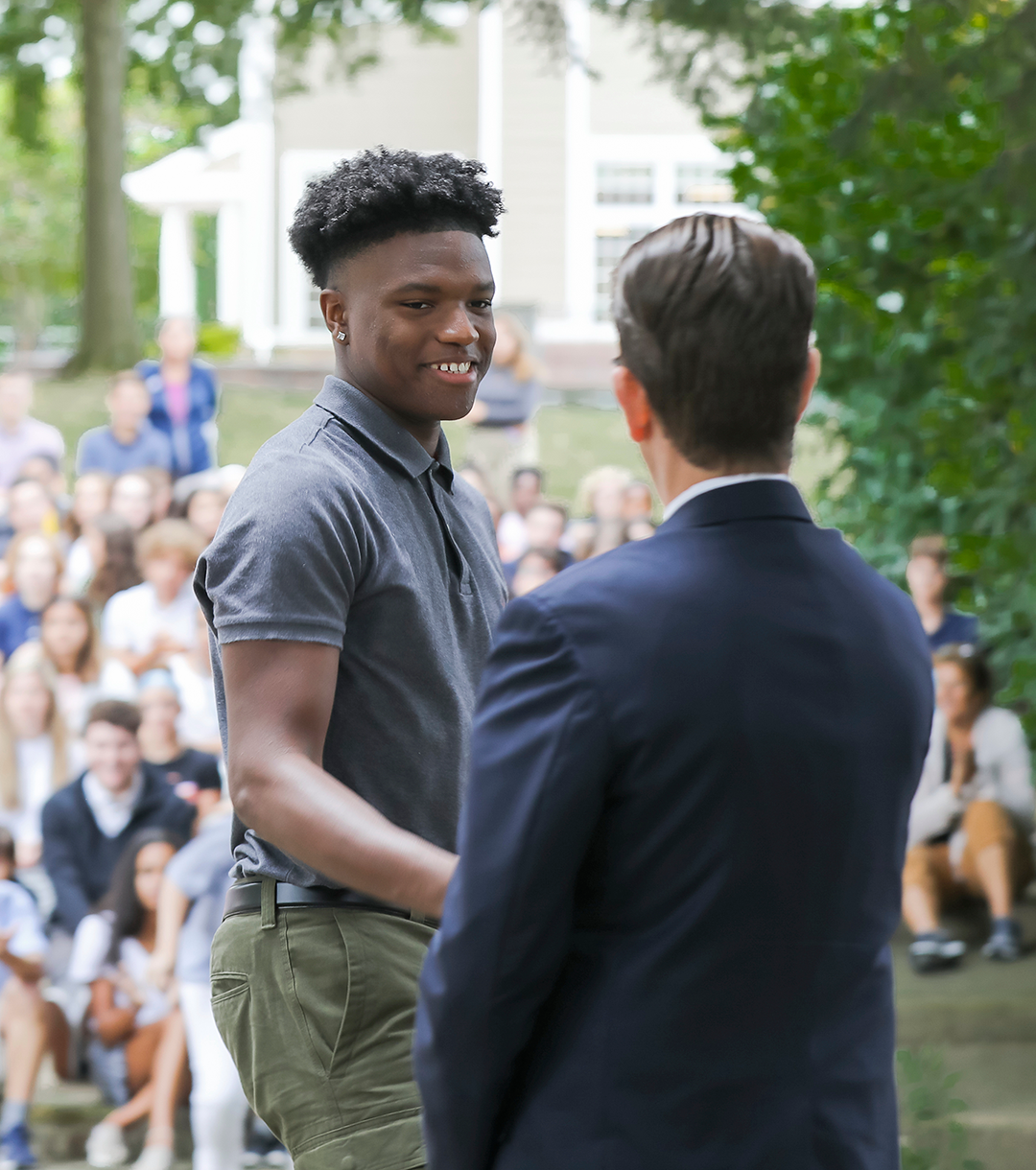 Head of School Mark Anderson congratulates senior Jyare Davis.