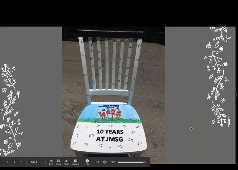 After 10 years at JMSG, faculty and staff receive a chair designed and painted by JMSG students.