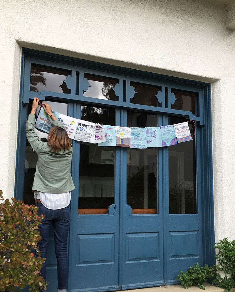 Our STEAM teacher Jodi along with the help of students, hung our Dream Flags in the school courtyard. In the Dream Flag Project, students studied the poetry of African American poet Langston Hughes. They then worked on their own poems and printed their words on a cloth flag, which was then decorated and hung on a line, much the way Tibetan prayer flags are displayed, meant to share positive hopes with the world.