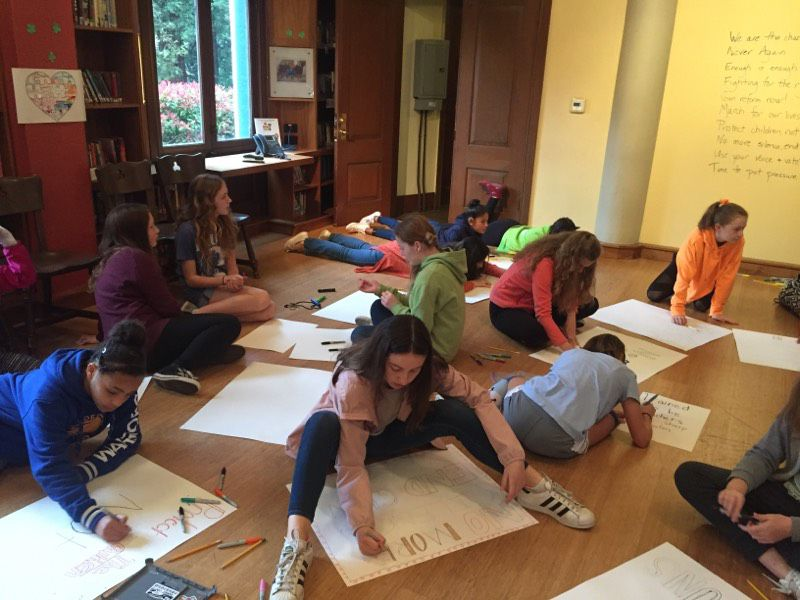 During Cornerstone on National School Walkout Day, girls came to the Ming Quong room to make signs for the Walkout. At 10:00AM, girls who wanted to join faculty and staff marched up to Mills Hall and back to school. At lunch, our School Counselor was available to speak with girls who wanted or needed to process more.