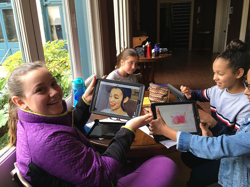 Manipulating photos on their iPad to create storyboard characters for an upcoming project in 6th grade Spanish class.