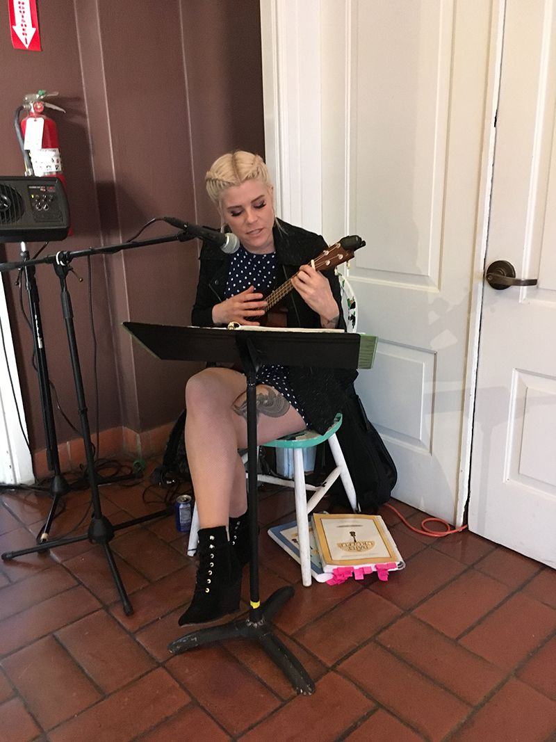 Guest Hilary serenades on her ukulele.