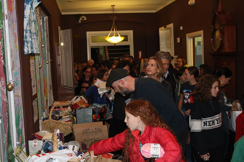 Guests sort the new and or gently used supplies for refugee families.