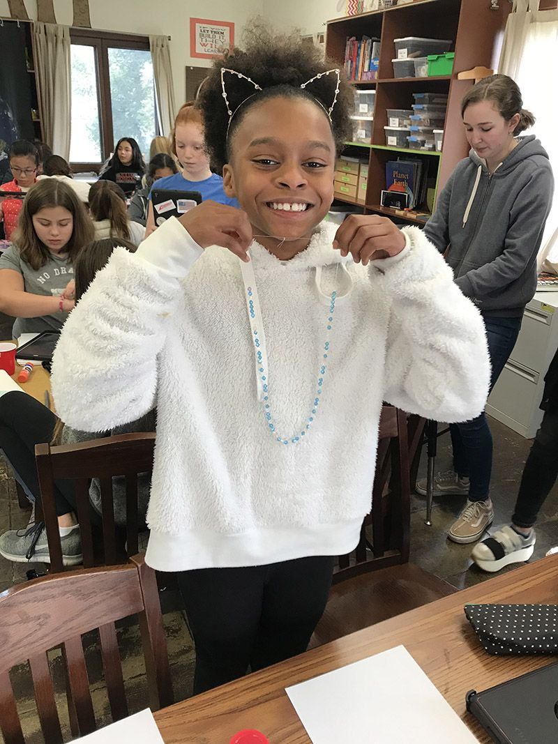 Sixth grade learned about binary coding and coded their names with beads on a necklace or bracelet.