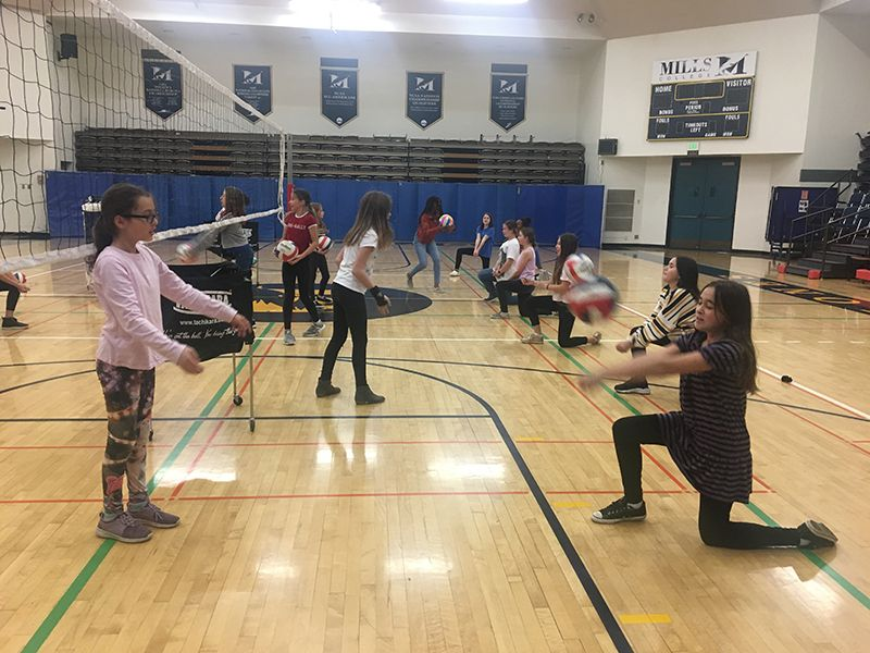 Sixth graders run through volleyball drills in PE class.