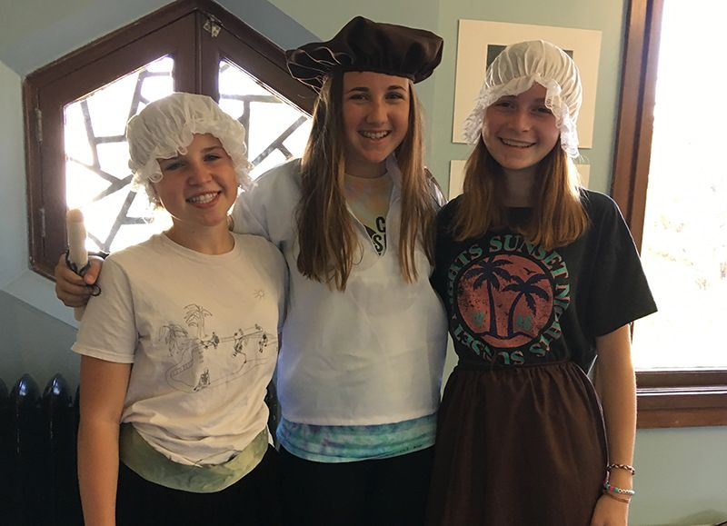 Eighth graders perform skits about the early colonization of America in History class.