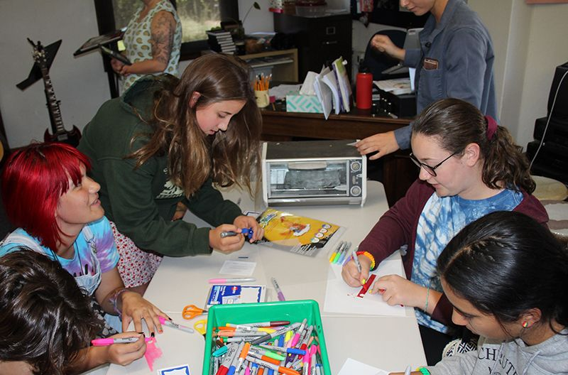 Students learn about the importance of National Coming Out Day and do art projects.