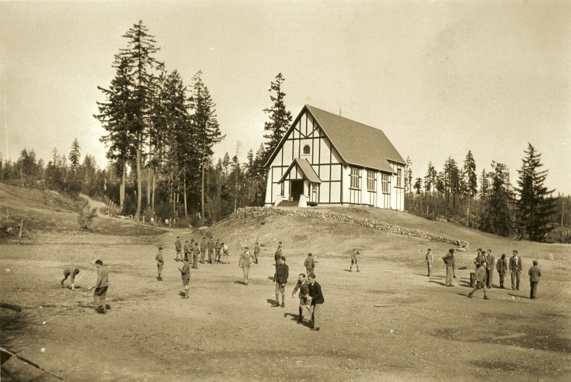 Boys playing outside the newly completed Chapel, 1928