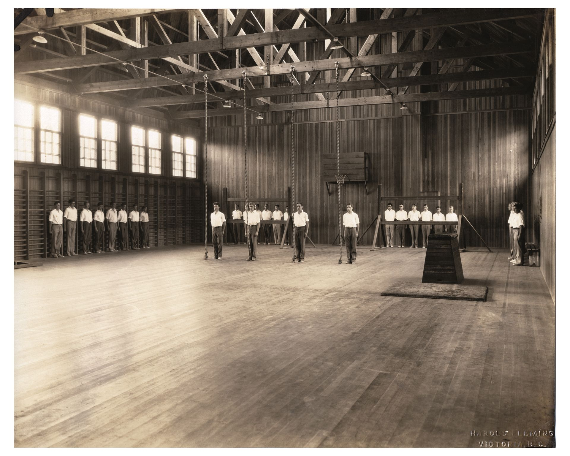 Boys ready to climb ropes in the gym, 1932