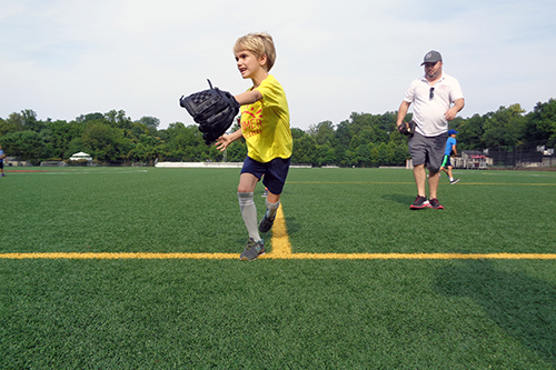 Sports Camper Running for a Groundball