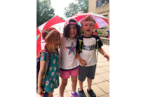Intermediate Campers Using Their Newly Designed Umbrella Hats from Art Class