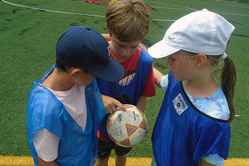 Sports Campers During Their Soccer Game Time-Out