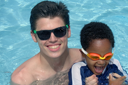 Lifeguard and Junior Camper During Free Swim