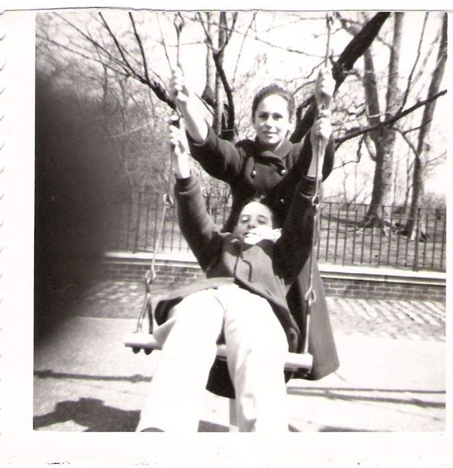 Terry Pristin and Charles Jacoby on swing taken by Joan Blair