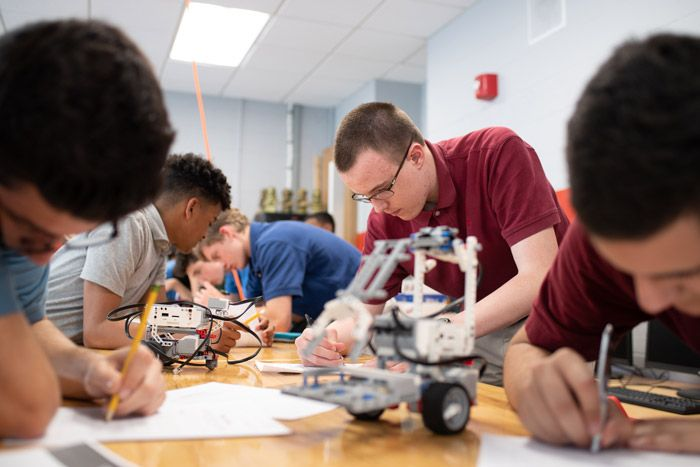 After completing modules on CAD software, coding, and robotics, students create companies specializing in software design, 3D printing, and robotics.