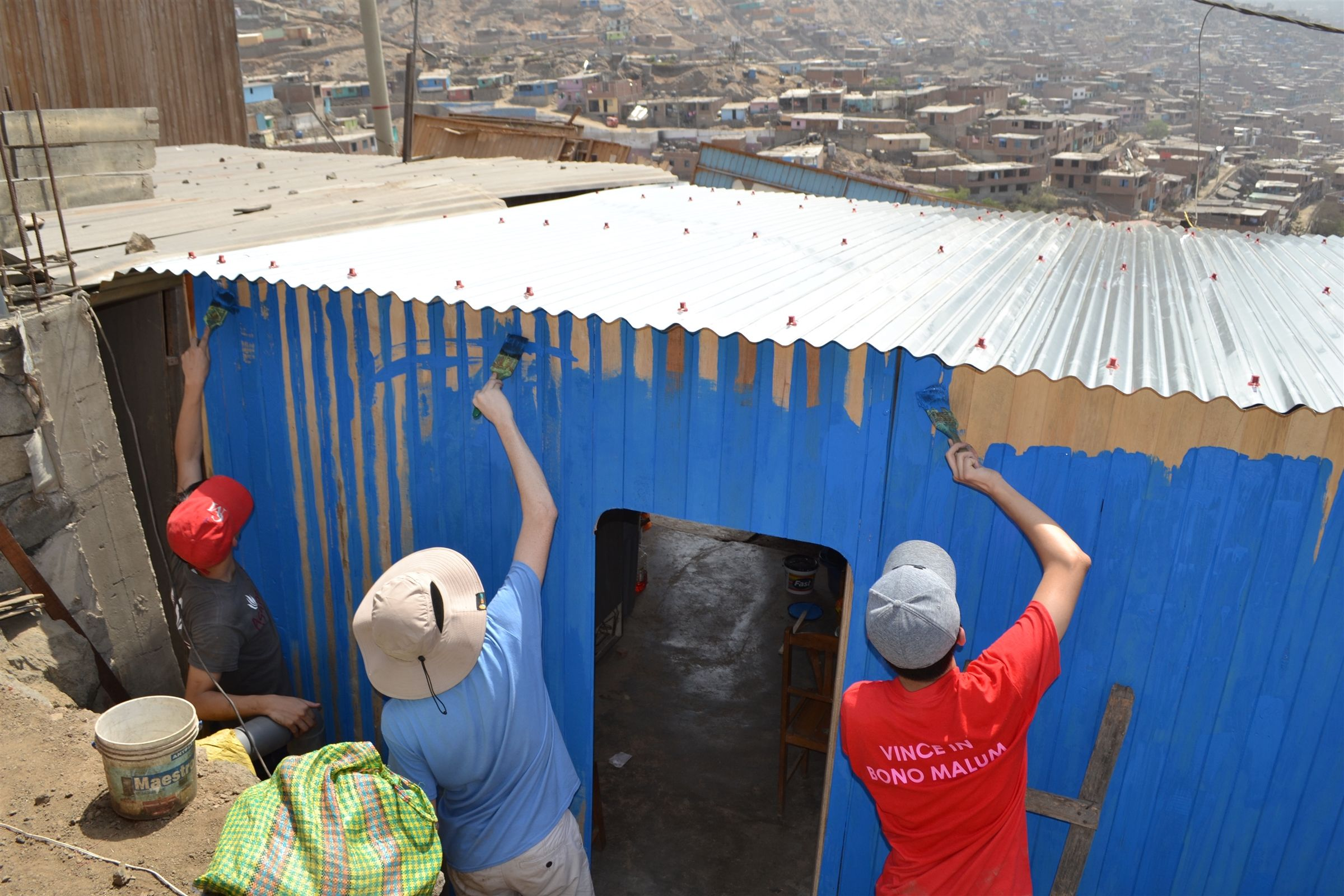 Students begin their service project in the Canto Grande neighborhood of Lima constructing a hillside house for a family. Over the two days, the boys assemble and paint the small home. The boys have the opportunity to meet and get to know the children of the family who will live in the home.