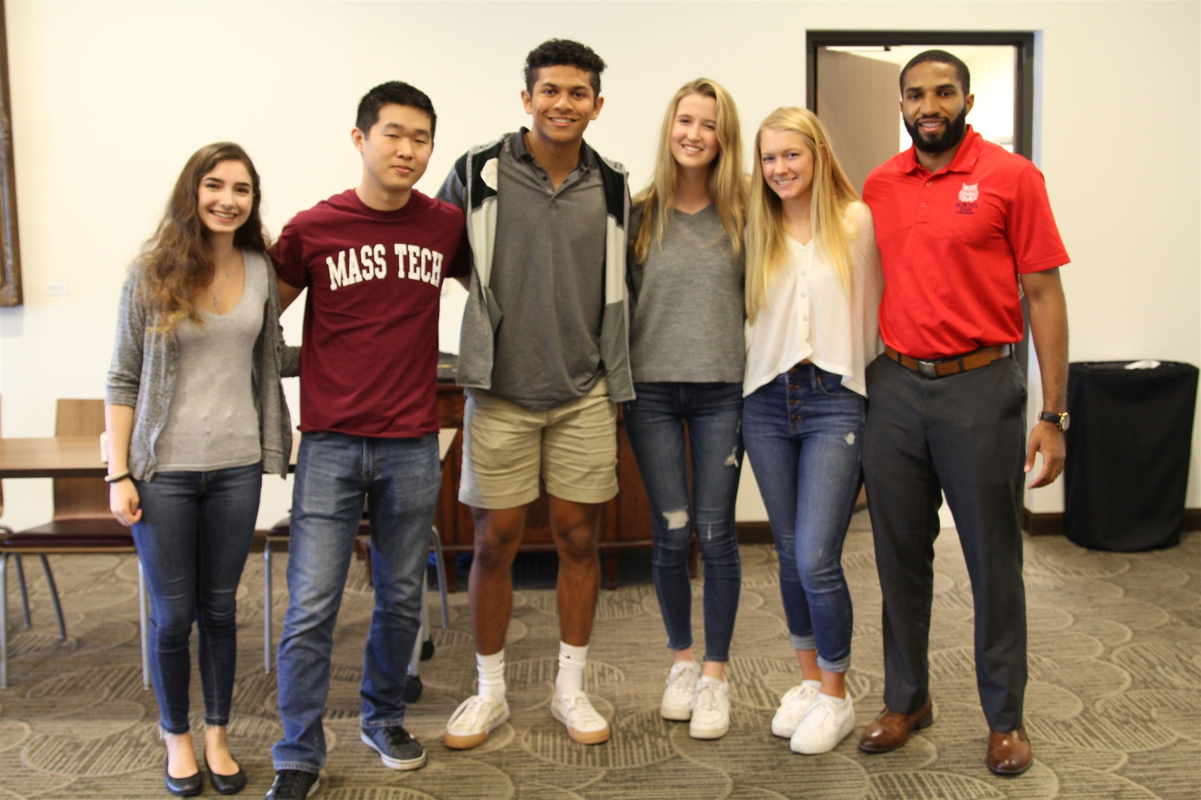 A group of Bishop's college-aged alumni shared their experience in college with upper school students and their parents.