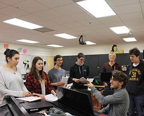 The JCHS Vocal Ensemble rehearsing