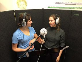 Tessa Zitter '17 and Eliana Aiken '17 recording a song.