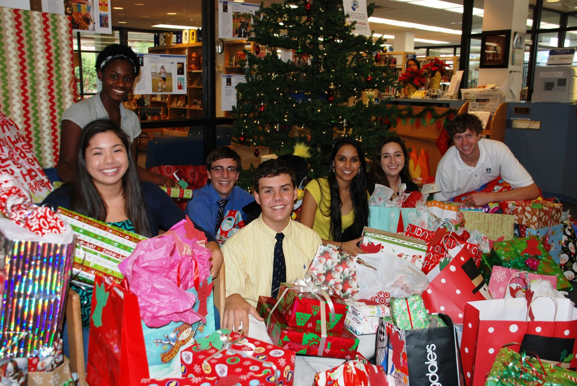 National Honor Society students arranging gifts for children.