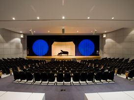 The Waxlax Center for the Performing Arts is an 808 seat theater divided into 5 seating divisions; each division includes an orchestra and mezzanine section. All orchestra seats are handicapped accessible; mezzanine seating requires stair access. The main curtain fully open has a 70-foot proscenium opening and a depth of over 45 feet. With 3-pairs of fully-adjustable black curtained legs, back curtain, white cyclorama, black scrim, white scrim, and a mid-stage traveler curtain, the stage is adjustable to create the intimacy for any event. Blue LED aisle lighting provides additional comfort and security.