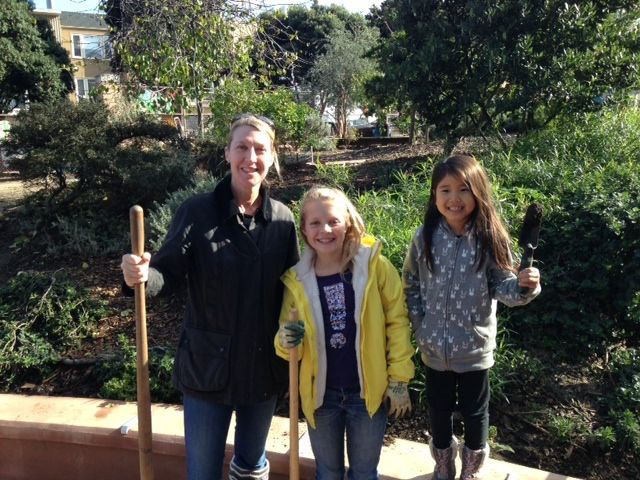 Students and parents participate in a community garden project with Sherman Elementary, a local public school.