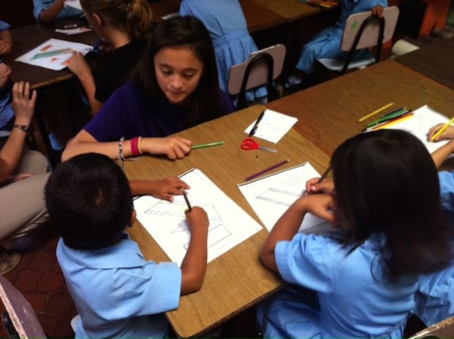 Hamlin students tutor younger Costa Rica children as part of their global service learning project.