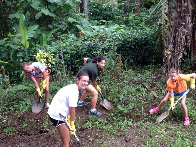 Students assisting a Costa Rican school with an outdoor community development project.