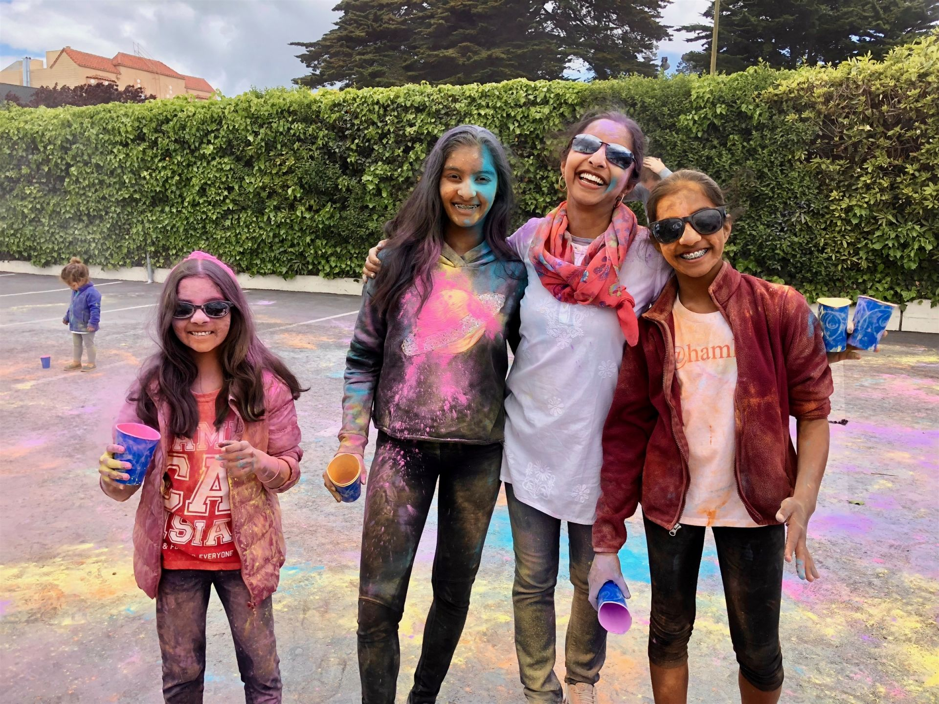 Hamlin students and families celebrating Holi, the Indian Festival of Color