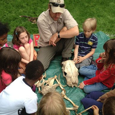 Scott Lembitz of Earth Spirit Educational Services discusses animal bones with first graders.