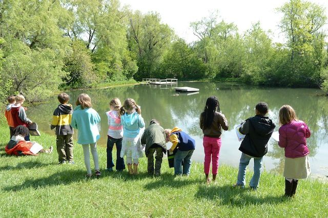 Green. Lower School students observe life (and record what they see in journals) near the Pond.