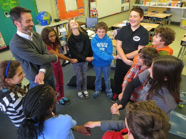 Kind. Middle School students engage in a Responsive Classroom closing circle activity.