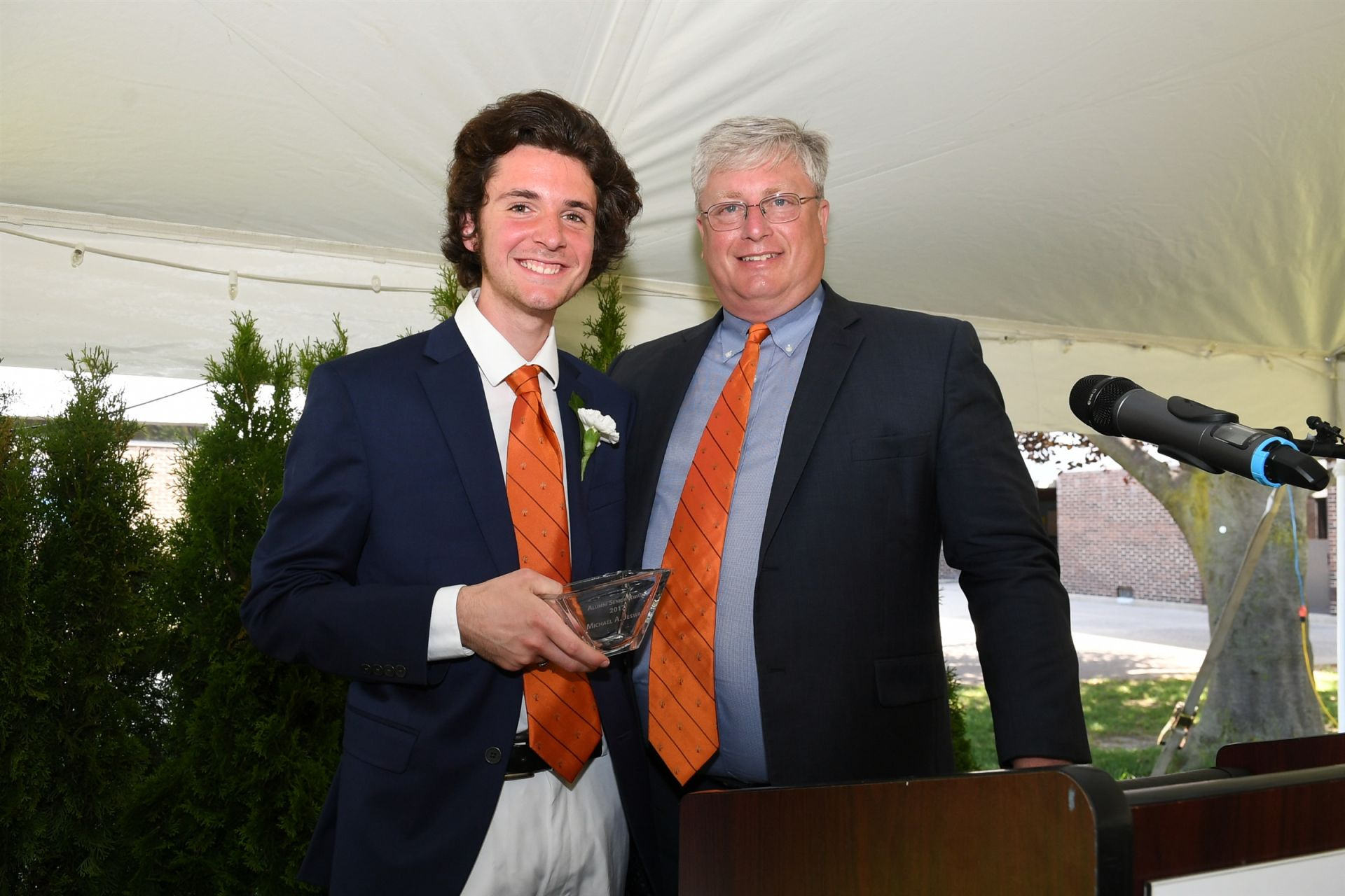 Michael Jeswald '17 receives the Alumni Senior Award on June 16, 2017 from Joe McMahon '83