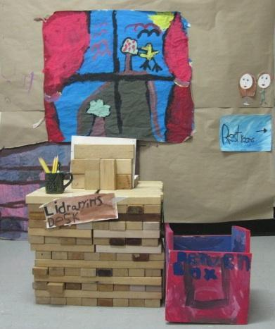 The 6s create a Library made from blocks, using signs and symbols to guide their visitors.