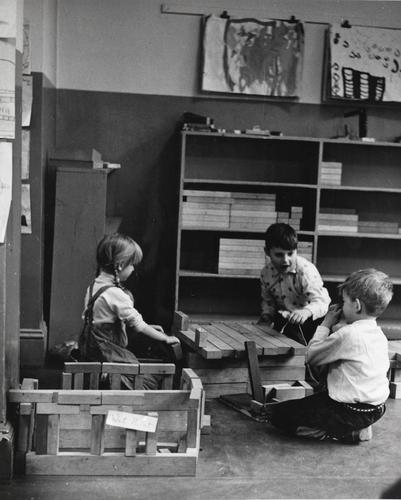 Caroline Pratt developed unit blocks in 1913 for her students at the Hartley Settlement House. They formed the core of the program when she opened the Play School the following year. As she was developing ideas for her new school, she envisioned a community of children who could reproduce the world and its functioning and she sought a flexible and adaptable material that children could use to do it.