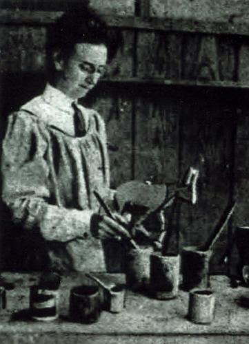 "(Pratt finishing ""Maude the Blue Mule"" in 1910)  Caroline Pratt designed, manufactured and sold a set of dolls she called Do-Withs. Read an article in the New York Herald from 1910 on Pratt's approach to toys and children's materials <a href=""https://cdn.media910.whipplehill.net/ftpimages/642/misc/misc_117460.pdf"">here</a>."