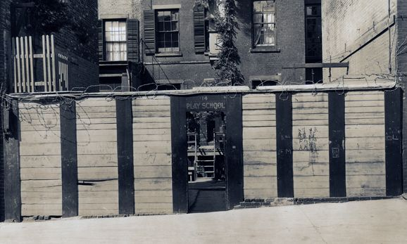 "14 MacDougal Alley, the site of the School from 1916-1921. ""PLAY SCHOOL"" is seen in paint at the front entrance to the School. The name changed to City and Country School around 1921, at the request of the children."