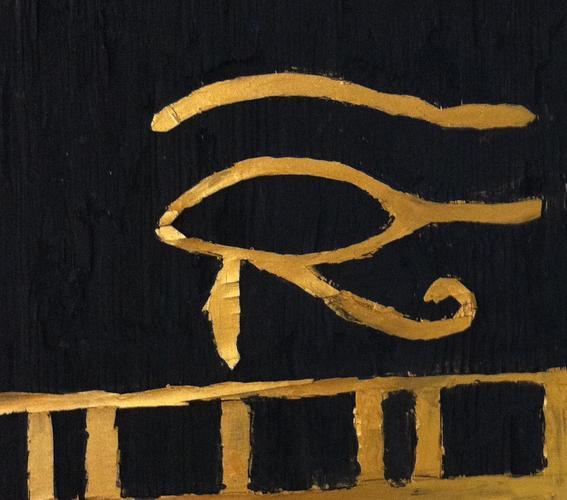 The 10s replicate ancient Egyptian artifacts and symbols in a variety of formats. Here, the Egyptian Eye of Horus is depicted in a painted wood carving.