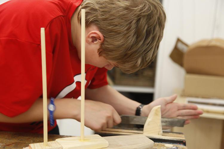 (A student concentrating on a shop project, 2012) Read more about C&C's commitment to woodworking <a href=