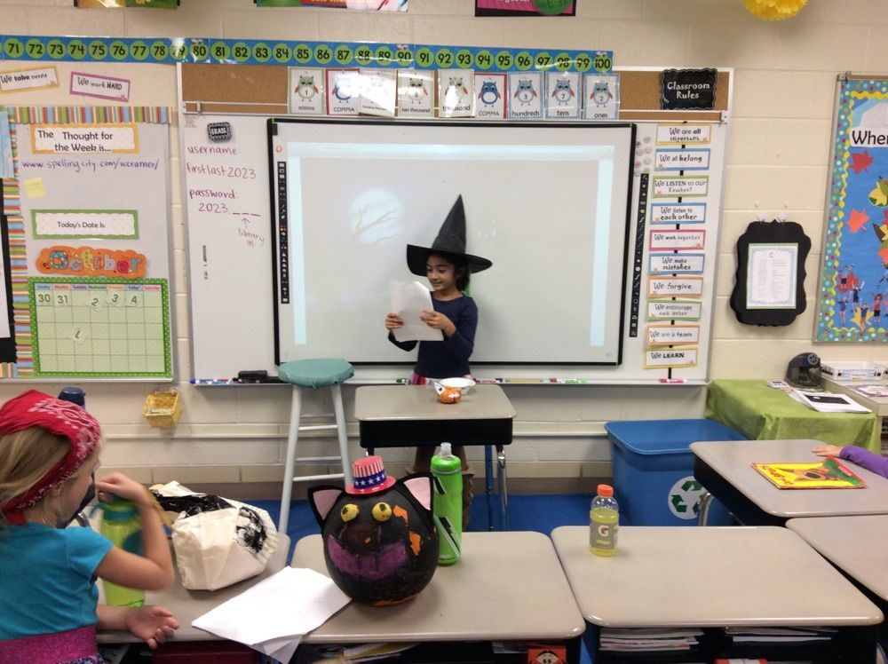 Students present their Pumpkin Projects.