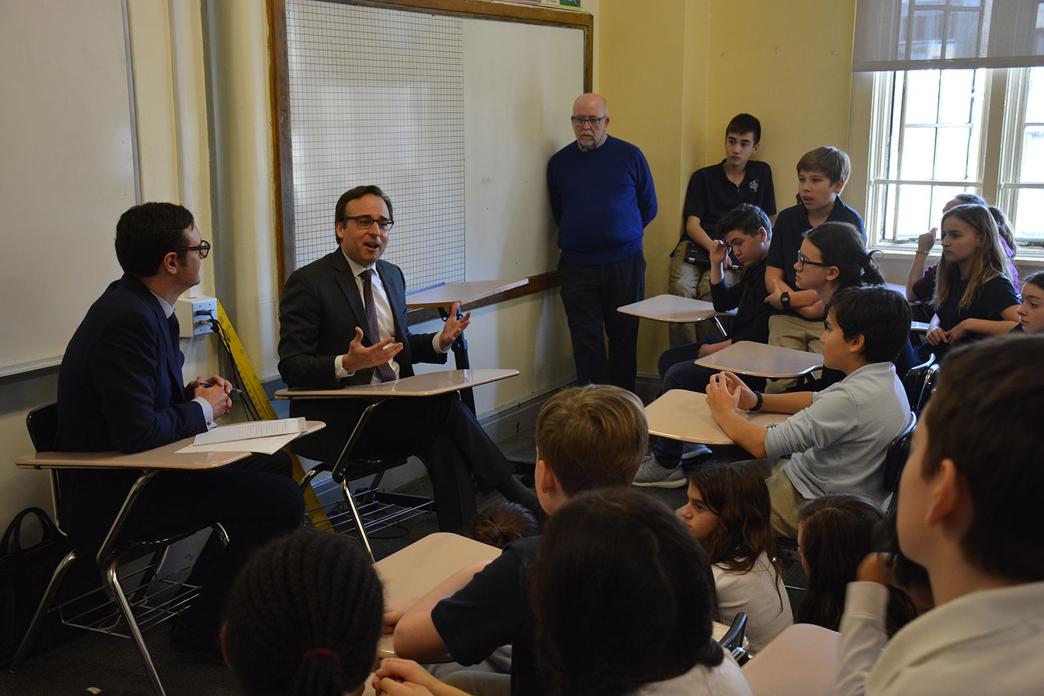 Ambassador David Pressman visits with students in Grade 7