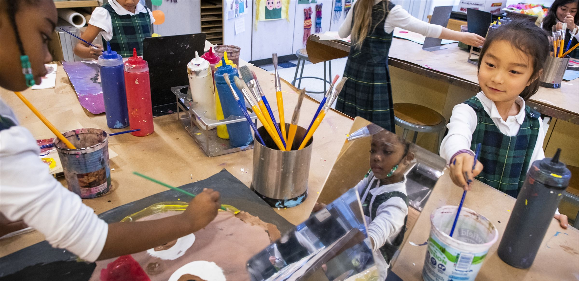 Lower School art students create self-portraits as part of their curriculum about identity.