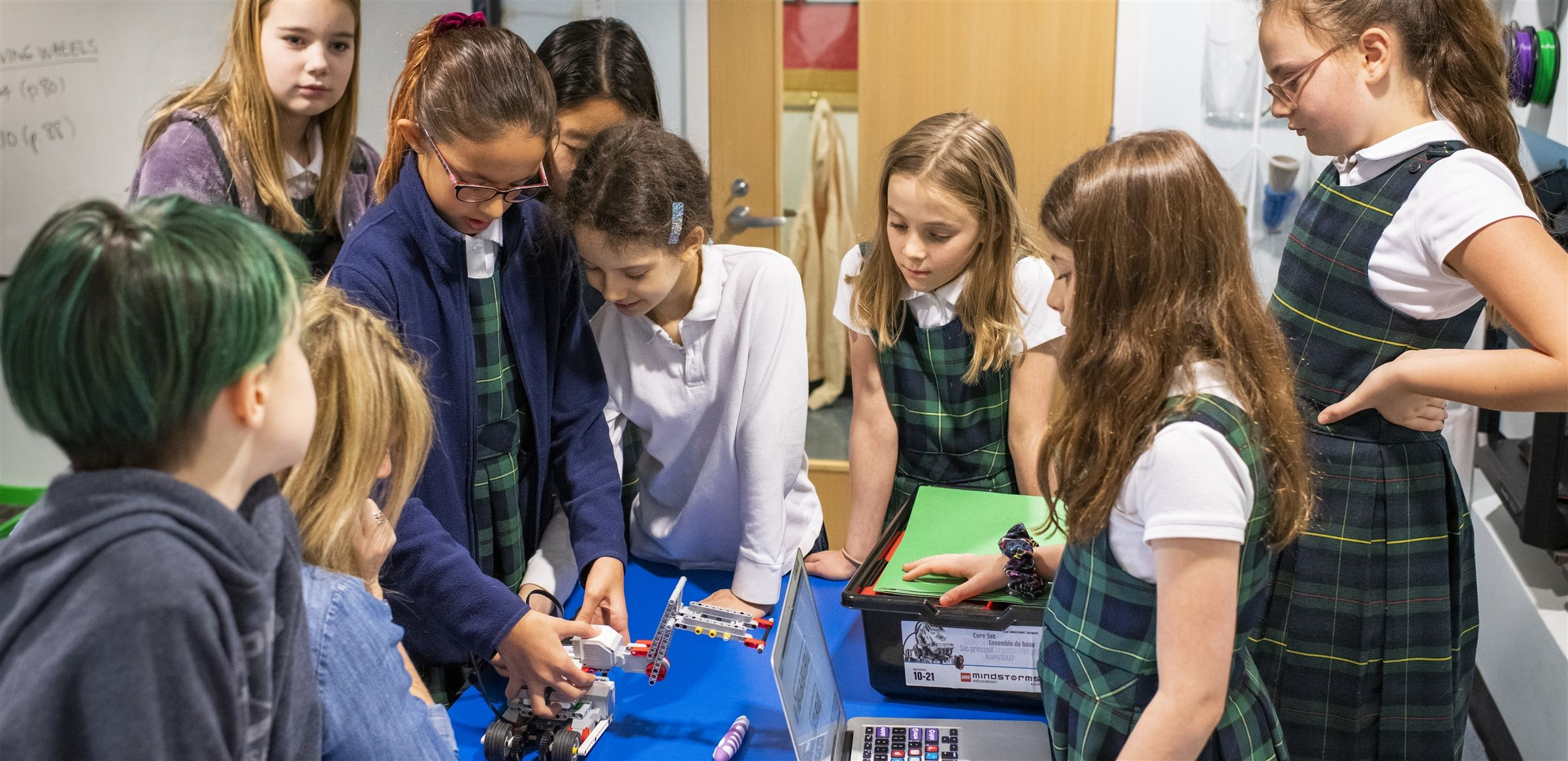 The Lower School STEAM curriculum includes building WeDo robots with motors, sensors and gears, learning to code and creating their own animations.