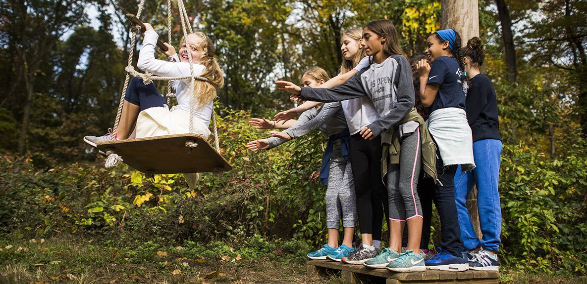 Grade 6 students learn to work together and support one another through team building activities at Alley Pond Park Adventure Course.