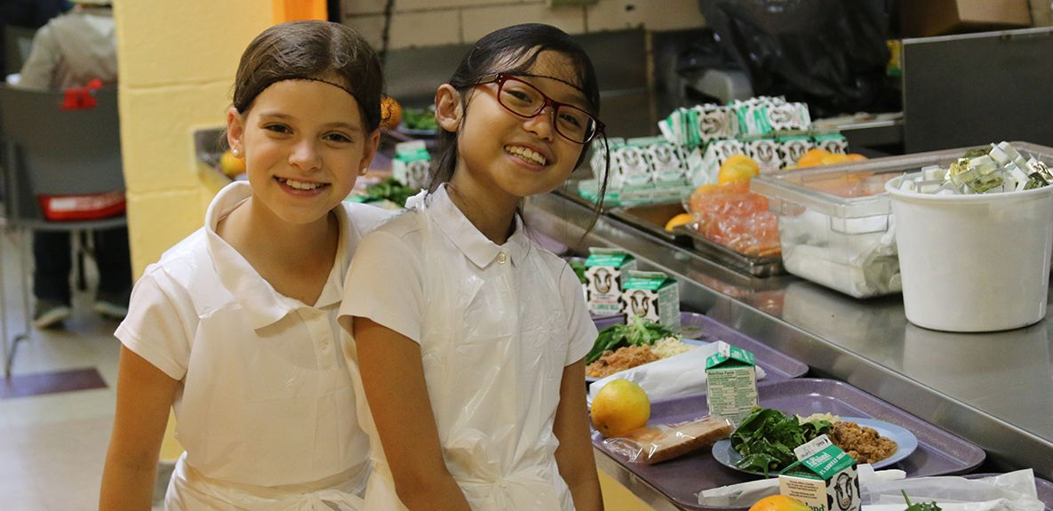 Grade 7 students serve lunch as part of the School's focus on service learning.