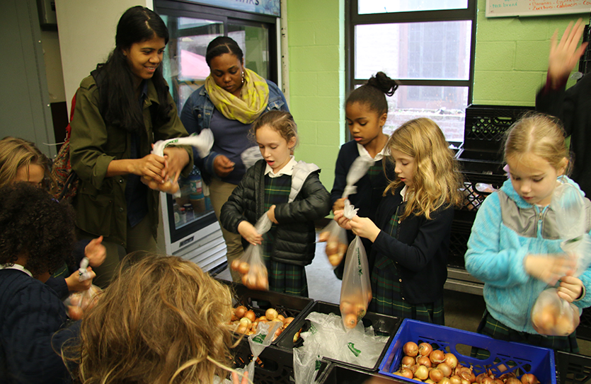 Grade 1 students volunteer at New York Common Pantry as a part of their service-learning project, reinforcing concepts of citizenship and leadership.