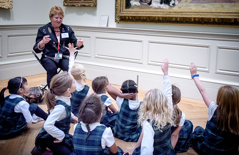 Kindergartners ask a few questions from a museum educator at The Met.