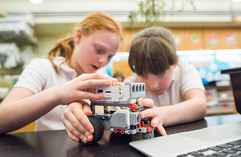 Grade 4 students host a robotics fair to showcase their coding, engineering and problem-solving skills.